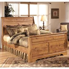 Ashley Furniture Bittersweet Queen Sleigh Bed in Light Brown