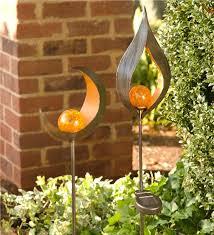 main image for lighted metal solar garden stake