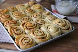 for this project of 24 rolls i used all three loaves of frozen bread dough that es in the package and baked them in a sheet pan lined with parchment