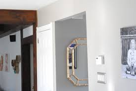 quick tip to add light to dark rooms hang a mirror wall