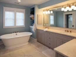 blue coastal inspired bathroom with pedestal tub