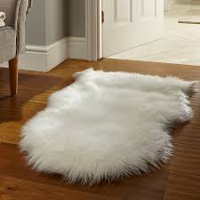 faux fur sheepskin rug in cream hover to zoom