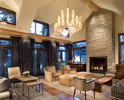 chandelier stone fireplace chairs table rug curtains