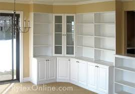 white cabinets with glass doors and shelving
