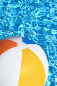 swimming pool beach ball background. Stock Photo - Summer Background. Beach Ball On The Swimming Pool Pool Beach Ball Background L