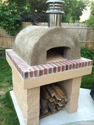 family wood fired outdoor pizza oven in by ovens burning diy