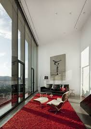 living room rug red white walls black sofa