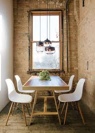 small industrial style dining room with lovely lighting from hennepin made lighting breakfast table lighting