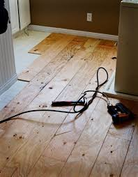 plywood floor much er than laminate a whole lot more durable just use a router to create the grooves