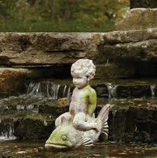 animals boy on fish garden statue