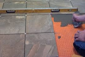 You lay the cleavage membrane so that the tile is offset from the ...
