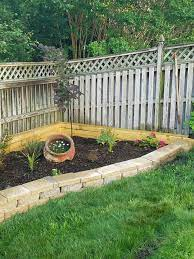 raised garden bed against fence