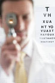 Eye Chart Poster Free Doctor Looking Through Ophthalmoscope With Eye Chart In Background D1230_10_635