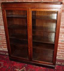 glass door bookcase decorating ideas varnished wood bookcase with antique oak cabinet