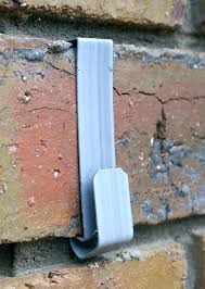 concrete wall hangers drilling brick how to attach without picture hook hanger hang pictures mirrors decorations concrete wall
