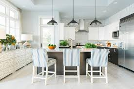 kitchen with thomas counter stools by ethan allen in the remodeled hgtv dream home beach house beach house kitchen nickel oversized pendant