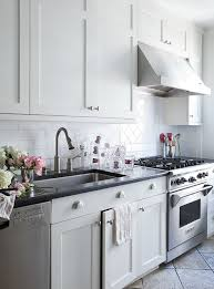 crisp white shaker kitchen cabinets with brushed nickel pulls hardware