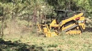 skid steer forestry mulcher invades