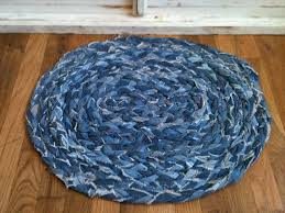 now i have a nice braided denim rug for my feet to stand on while i wash dishes in the kitchen and our old denim jeans have a whole new life