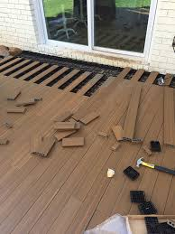 to lay deck flooring on a concrete patio
