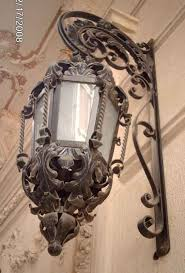 wall mount wrought iron lighting fixture design this must be the sister to the lamp post in the lion the witch and the wardrobe