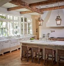 French Country Kitchen with great windows, vintage cabinetry, exposed  beams, rustic lanterns,
