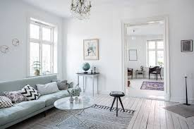 mint green sofa in a light home