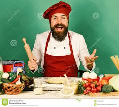 Chef With Pasta Vegetables And Dough On Table Cook With Excited