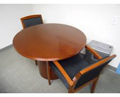 we have three 3 of these beautiful 42 round conference tables or meeting tables that match our cherryman wood private office suites