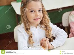 student sitting at desk hands folded. Interesting Sitting Download Girl Sitting With Hands Clasped In Classroom Stock Photo  Image  Of Girl Kindergarten Intended Student At Desk Folded U