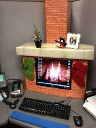 falling snow made from threaded cotton balls and plenty of christmas lights this gingerbread house cubicle gets the award for best use balloons decorating an office c63 office