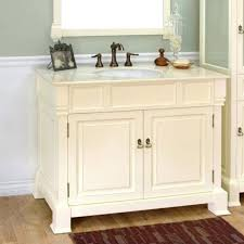 sage green wall color with excellent off white vanity using dark colored striped rug for classic bathroom plan