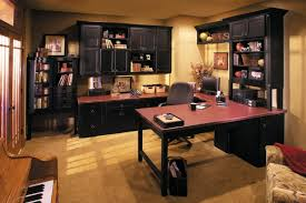 cozy contemporary home office. inovative design for black cabinets and shelves in elegant home office with wide desk cozy swivel chair on brown flooring under beige ceiling contemporary o