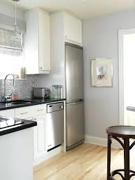 gray kitchen walls kitchens blue white cabinets absolute black granite mosaic glass tiles with cherry