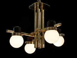 mid century brass chandelier with teak fittings