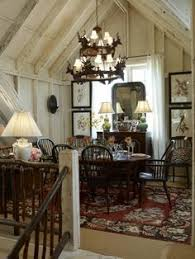 there is something utterly inviting about this dining room tucked upstairs in a rustic loft even with the obvious challenge of carrying food and dishes up charming pernk dining room