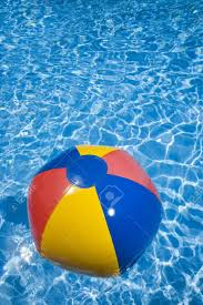 beach ball in pool. Beach Ball In A Sparkling Blue Swimming Pool Stock Photo - 7757706 E