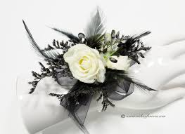 prom 022 35 plus tax and delivery black wrist corsage with white roses black feathers black ribbon black jewels and black limonium