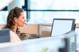 woman office furniture. Woman Talking On Phone And Using Computer In Her Cubicle. Office Furniture