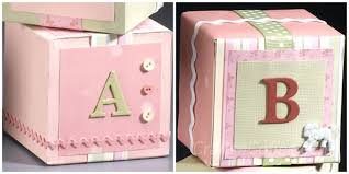 Sweet, custom baby blocks decorated with paper, buttons, ribbons, etc. Easy