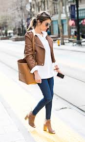 just the design christine andrew is wearing a camel faux leather jacket with a madewell