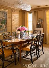 paneled wood walls make for an intimate dining room with plenty of hidden storage photo