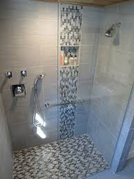likeable shower designs with glass tile for bathroom renovation ideas chrome wall mounted waterfall on gray ceramic wall panel with glass mosaic accent