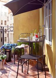 cool outdoor furniture ideas. unique outdoor a sunny balcony with grey table and chairs combined a semicircular  parasol to cool outdoor furniture ideas