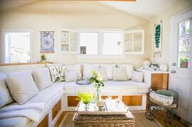 small living room venice beach cottage built in sofa couch bench living room sisal rug cococoy built in living room furniture