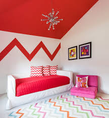 ... accent pillows and feature wall add chevron pattern to the stylish kids  room [
