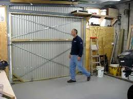 bi fold garage doorshangar style bifold door on my shed 1  YouTube
