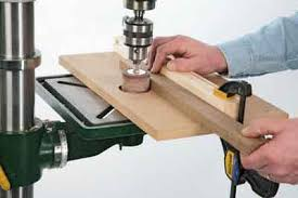 drum sander for drill. rigging up a temporary fence turns the drum sander into mini thicknesser, allowing you for drill