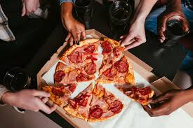 four friends pany eat fresh pizza at home 5aa b fefac0
