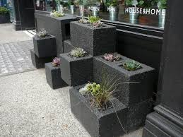 With a little paint, some cinder blocks and small plants, you can have  yourself some very cool planters in no time.